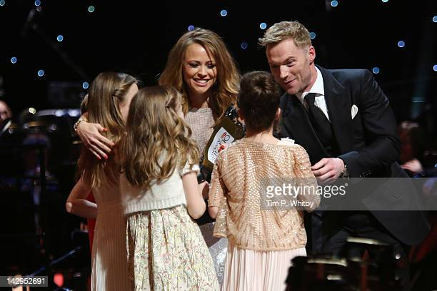 Ronan Keating and Kimberley Walsh present Sophia Kiely Kerry Ingram Eleanor Worthington Cox and Cleo Demetriou with the award for Best Actress in a...