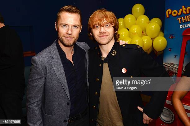 Ronan Keating and Rupert Grint attend the UK premiere of 'Postman Pat' at the Odeon West End on May 11 2014 in London England