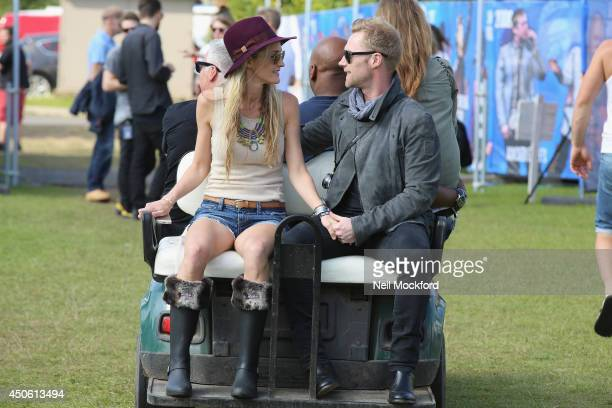 Ronan Keating and Storm Uechtritzduring seen backstage at The Isle of Wight Festival at Seaclose Park on June 14 2014 in Newport Isle of Wight