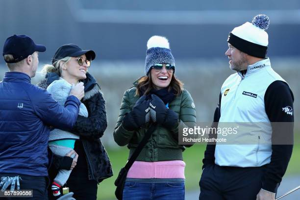 Ronan Keating his wife Storm Keating and baby Cooper stand with Lee Westwood of England and his girlfriend Helen Storey during day one of the 2017...