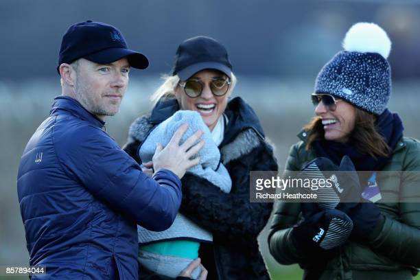 Ronan Keating his wife Storm Keating and baby Cooper stand with the girlfriend of Lee Westwood Helen Storey during day one of the 2017 Alfred Dunhill...