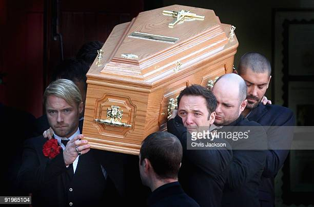 Ronan Keating Mikey Graham and Shane Lynch carry out the coffin after the funeral of Boyzone singer Stephen Gately at St Laurence O'Toole Church on...