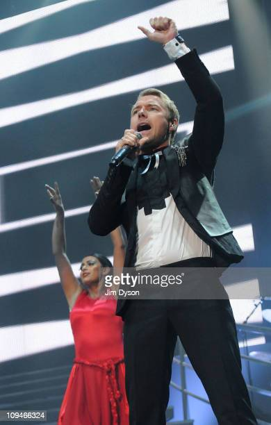 Ronan Keating of Irish group Boyzone performs live on stage at Wembley Arena during the Brother Tour which is dedicated to the late Stephen Gately on...
