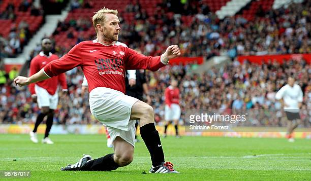 Ronan Keating plays football at United For Relief The Big Red Family Day Out at Old Trafford on May 1 2010 in Manchester England