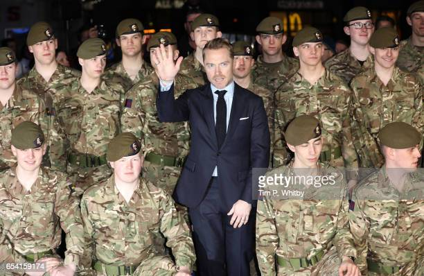 Ronan Keating poses with members of the Armed Forces at the World Premiere of 'Another Mother's Son' on March 16 2017 at Odeon Leicester Sqaure in...