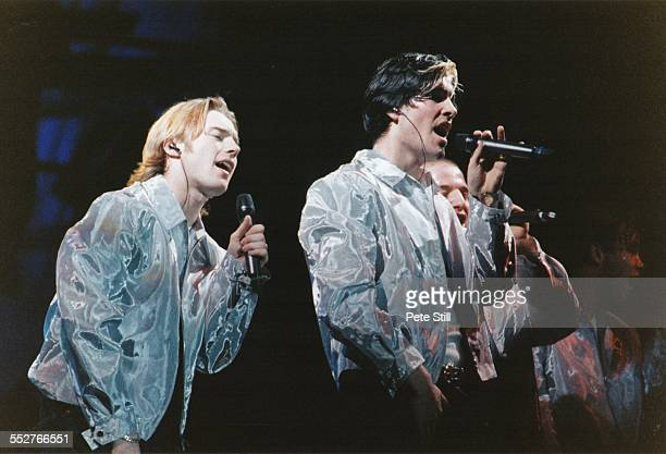 Ronan Keating, Shane Lynch, Mikey Graham and Stephen Gately of Boyzone perform on stage at the National Exhibition Centre, on December 7th, 1996 in...