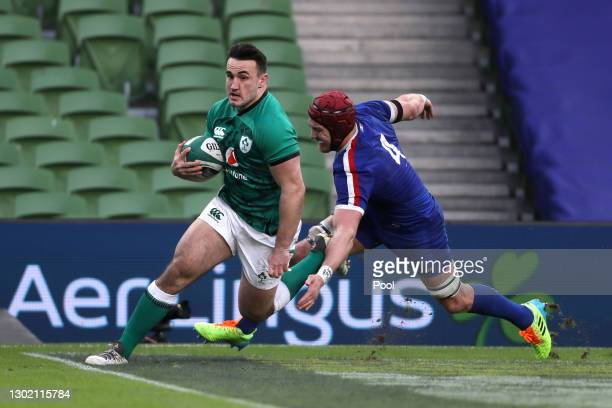 Ronan Kelleher of Ireland goes past Bernard le Roux of France to score their side's first try during the Guinness Six Nations match between Ireland...