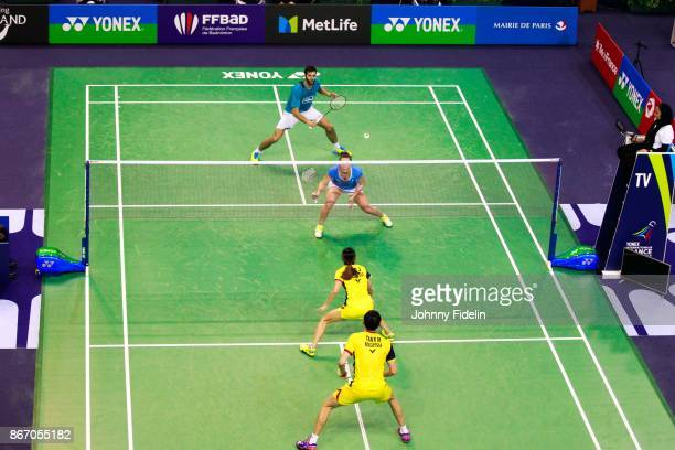 Ronan Labar and Audrey Fontaine of France against Meng Kian Tan and Jing Pei Lai of Malaysia during the Yonex Badminton French Open at Stade Pierre...