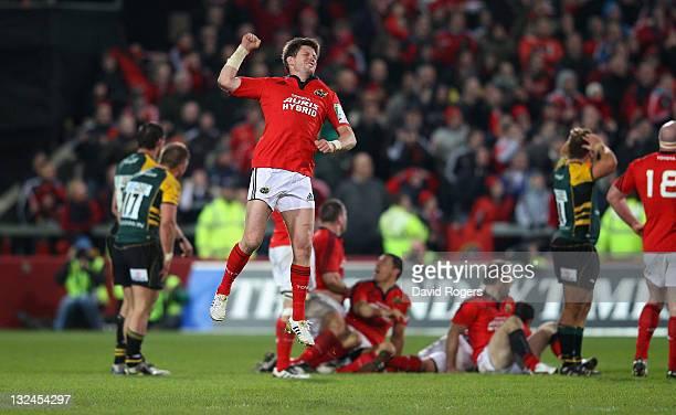 Ronan O'Gara of Munster celebrates after kicking the last minute, match winning drop goal during the Heineken Cup match between Munster and...