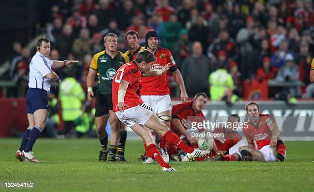 Ronan O'Gara of Munster kicks the last minute, match winning drop goal during the Heineken Cup match between Munster and Northampton Saints at...