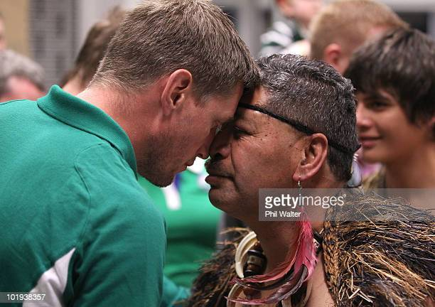 Ronan O'Gara of the Ireland rugby team shares a traditional Maori greeting of a Hongi as the team arrives at New Plymouth Airport ahead of their test...