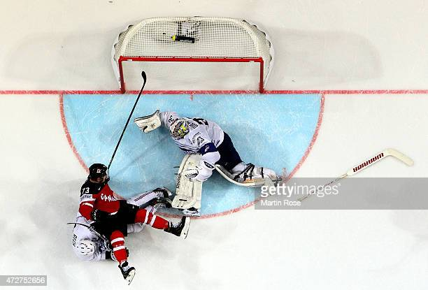 Ronan Quemener goltender of France maks a save on Tyler Toffoli of Canada during the IIHF World Championship group A match between France and Canada...
