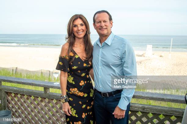 Ronda Axelowitz and Vice Chair Mark Axelowitz attend the David Lynch Foundation 15th Anniversary at the Bridgehampton Tennis and Surf Club on July 26...