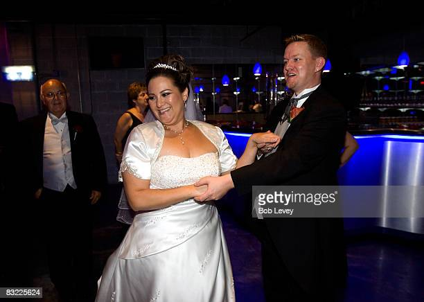 Ronda Lotter and Nathan Rhodes celebrate their reception on October 10 2008 in Houston Texas The Survivor Foundation a notforprofit organization...