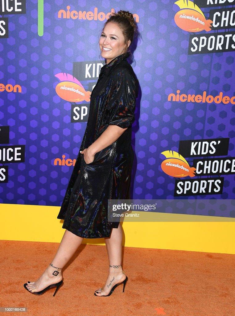 Ronda Rousey arrives at the Nickelodeon Kids' Choice Sports Awards 2018 at Barker Hangar on July 19, 2018 in Santa Monica, California.