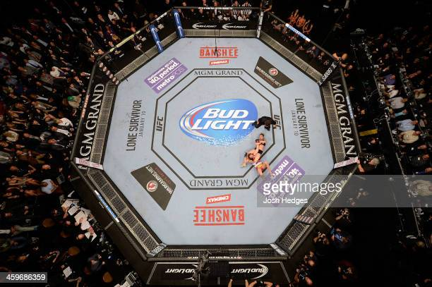 Ronda Rousey attempts to submit Miesha Tate in their UFC women's bantamweight championship bout during the UFC 168 event at the MGM Grand Garden...