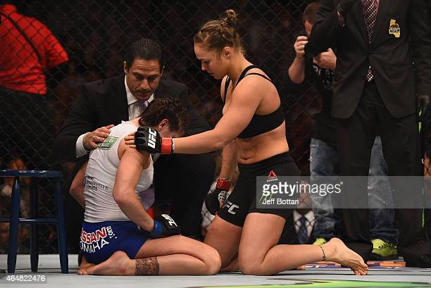 Ronda Rousey consoles Cat Zingano after their UFC women's bantamweight championship bout during the UFC 184 event at Staples Center on February 28...