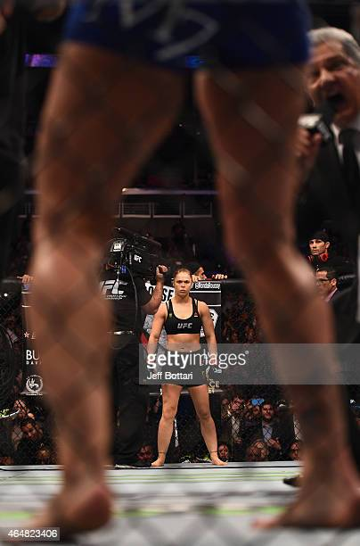 Ronda Rousey enters the Octagon in her UFC women's bantamweight championship bout against Cat Zingano during the UFC 184 event at Staples Center on...