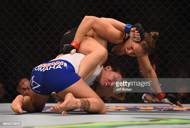 Ronda Rousey grapples with Cat Zingano in their UFC women's bantamweight championship bout during the UFC 184 event at Staples Center on February 28...