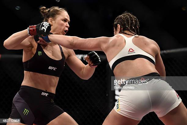 Ronda Rousey of the United States and Bethe Correia of Brazil exchange punches in their bantamweight title fight during the UFC 190 Rousey v Correia...