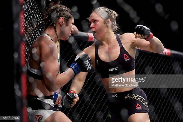 Ronda Rousey of the United States defeats Bethe Correia of Brazi l in their bantamweight title fight during the UFC 190 Rousey v Correia at HSBC...