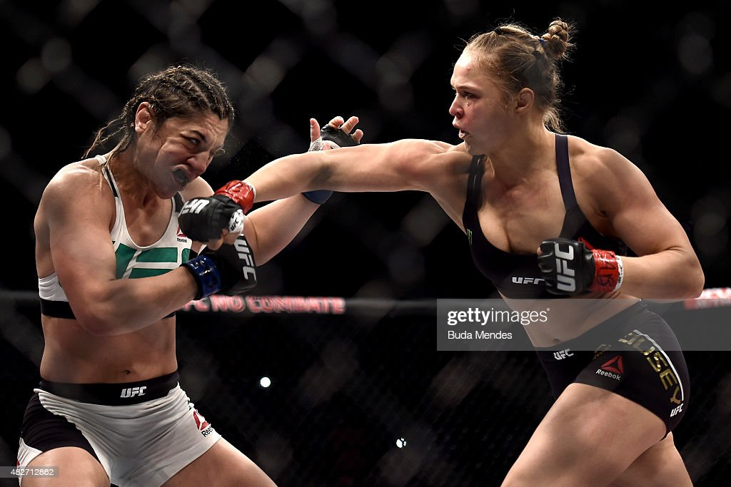 Ronda Rousey of the United States punches Bethe Correia of Brazil in their bantamweight title fight during the UFC 190 Rousey v Correia at HSBC Arena on August 1, 2015 in Rio de Janeiro, Brazil.