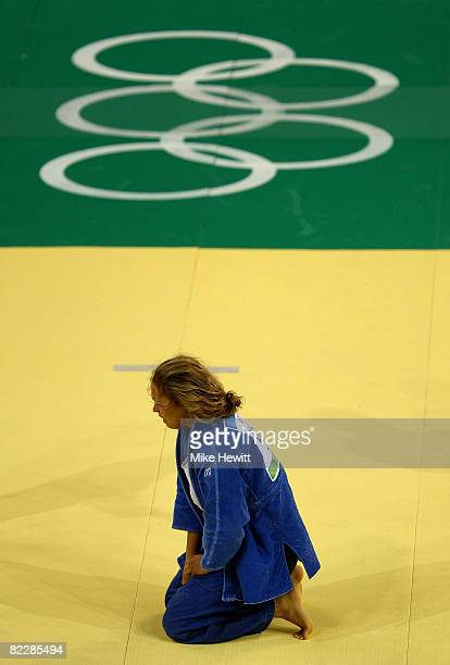Ronda Rousey of the United States reacts after defeating Annett Boehm of Germany after their Women's 70 kg Bronze Medal Contest judo bout at the...