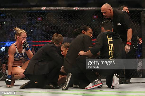 Ronda Rousey of the United States receives medical treatment after being defeated by Holly Holm of the United States in their UFC women's...