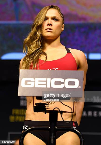 Ronda Rousey poses on the scale during the UFC 207 weighin at TMobile Arena on December 29 2016 in Las Vegas Nevada
