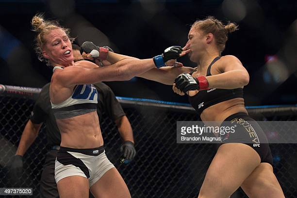 Ronda Rousey punches Holly Holm in their UFC women's bantamweight championship bout during the UFC 193 event at Etihad Stadium on November 15 2015 in...