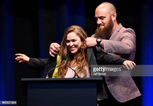 Ronda Rousey receives her hall of fame jacket after being inducted into the UFC Hall of Fame during the UFC Hall of Fame Class of 2018 Induction...