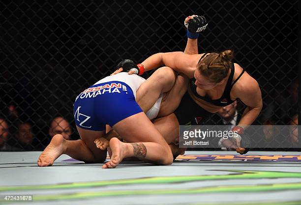 Ronda Rousey sets up and armbar against Cat Zingano in their UFC women's bantamweight championship bout during the UFC 184 event at the Staples...