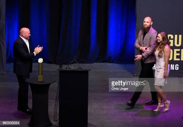 Ronda Rousey walks on stage with husband Travis Browne as she is inducted into the UFC Hall of Fame during the UFC Hall of Fame Class of 2018...