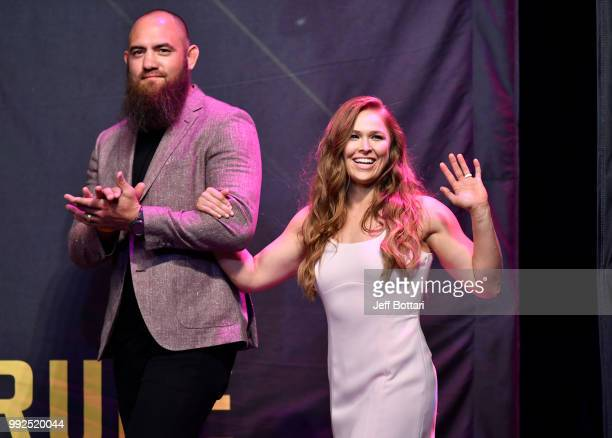 Ronda Rousey walks on stage with husband Travis Browne during the UFC Hall of Fame Class of 2018 Induction Ceremony inside The Pearl concert theater...