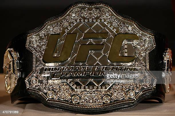 Ronda Rousey's UFC women's bantamweight championship belt is seen sitting on a table before the final UFC 170 prefight press conference at the...