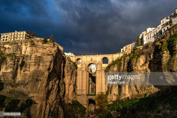 ronda village bridge during sunset - ronda stock pictures, royalty-free photos & images