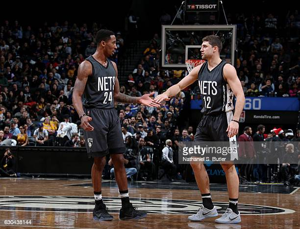Rondae HollisJefferson and Joe Harris of the Brooklyn Nets shake hands during a game against the Golden State Warriors on December 22 2016 at...