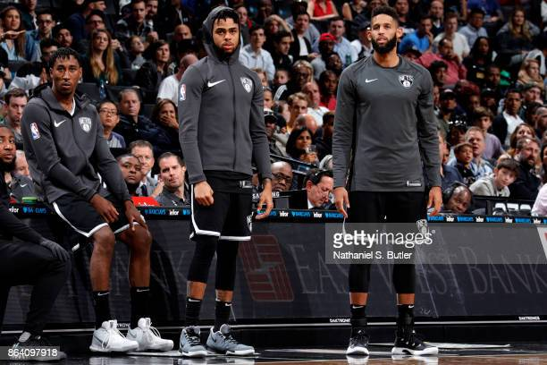 Rondae HollisJefferson D'Angelo Russell and Allen Crabbe of the Brooklyn Nets look on during the game against the Orlando Magic on October 20 2017 at...
