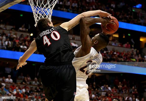 Rondae HollisJefferson of the Arizona Wildcats is fouled by Matt Shrigley of the San Diego State Aztecs in the second half during the regional...