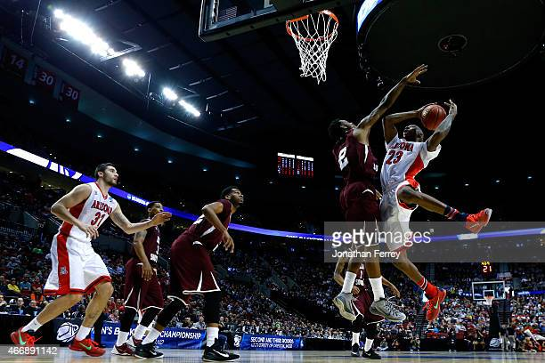 Rondae Hollis-Jefferson of the Arizona Wildcats puts up a shot as he is defended by Chris Thomas of the Texas Southern Tigers in the first half...