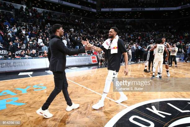 Rondae HollisJefferson of the Brooklyn Nets and Jabari Parker of the Milwaukee Bucks shake hands after the game on February 4 2018 at Barclays Center...