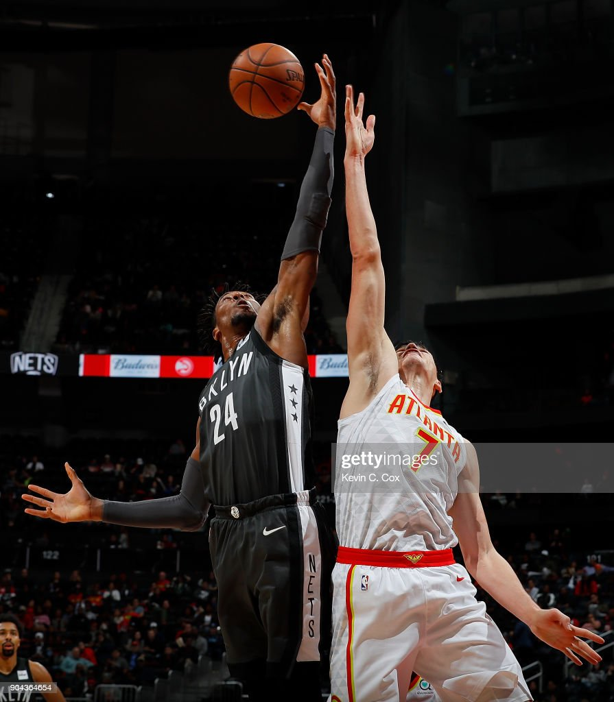Rondae Hollis-Jefferson #24 of the Brooklyn Nets battles for a rebound against Ersan Ilyasova #7 of the Atlanta Hawks at Philips Arena on January 12, 2018 in Atlanta, Georgia.
