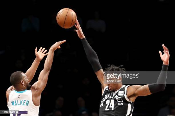 Rondae HollisJefferson of the Brooklyn Nets blocks a shot by Kemba Walker of the Charlotte Hornets in the first quarter during their game at Barclays...