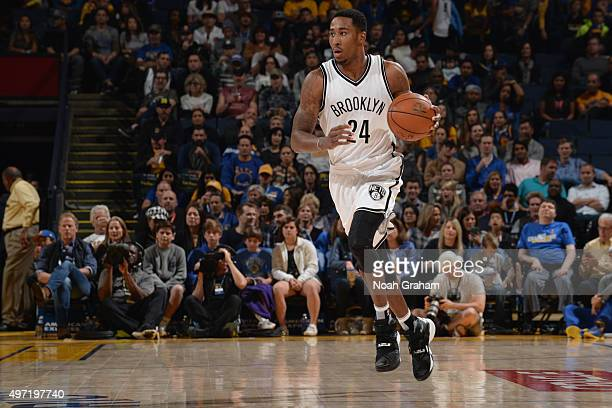 Rondae HollisJefferson of the Brooklyn Nets brings the ball up court against the Golden State Warriors on November 14 2015 at Oracle Arena in Oakland...