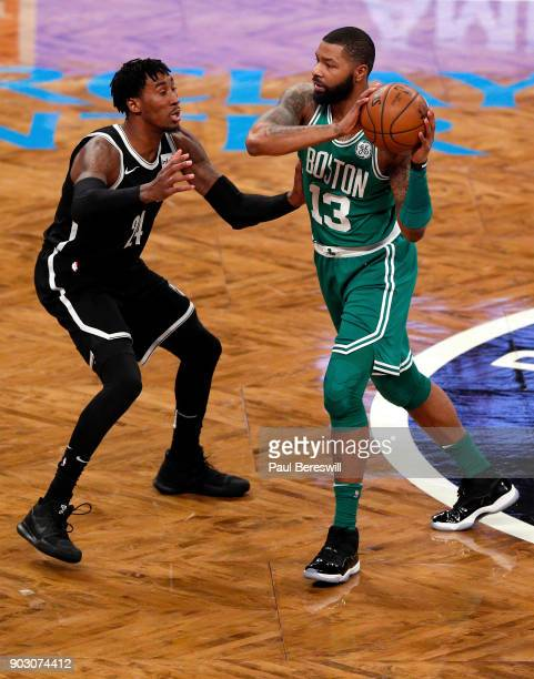 Rondae HollisJefferson of the Brooklyn Nets defends against Marcus Morris of the Boston Celtics in an NBA basketball game on January 6 2018 at...