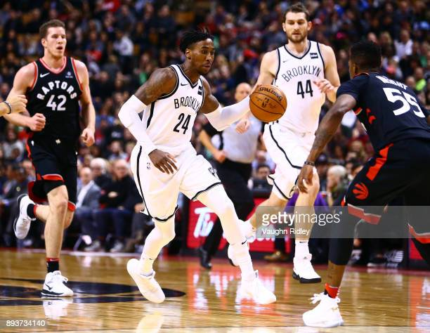 Rondae HollisJefferson of the Brooklyn Nets dribbles the ball as Delon Wright of the Toronto Raptors defends during the first half of an NBA game at...