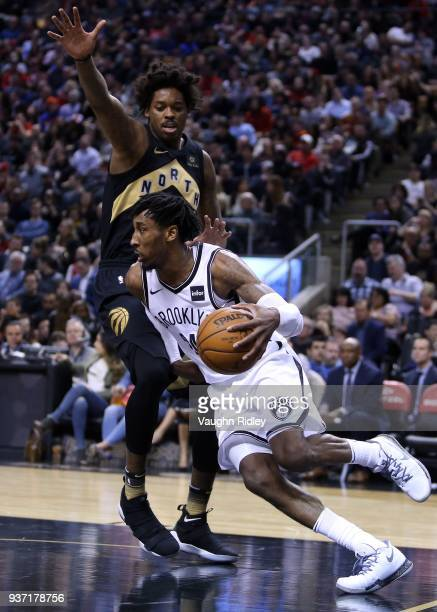 Rondae HollisJefferson of the Brooklyn Nets dribbles the ball as Lucas Nogueira of the Toronto Raptors defends during the second half of an NBA game...