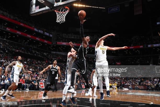 Rondae HollisJefferson of the Brooklyn Nets drives to the basket against the Denver Nuggets on October 29 2017 at Barclays Center in Brooklyn New...