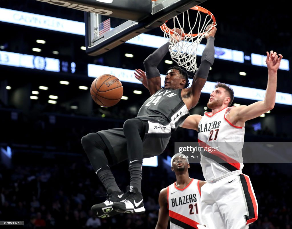 Rondae Hollis-Jefferson #24 of the Brooklyn Nets dunks the ball against Jusuf Nurkic #27 of the Portland Trail Blazers in the first quarter at Barclays Center on November 24, 2017 in the Brooklyn borough of New York City.