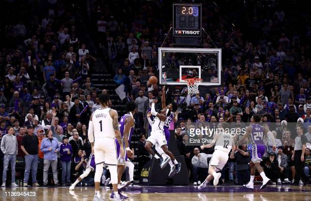 Rondae Hollis-Jefferson of the Brooklyn Nets makes the game-winning shot while guarded by Marvin Bagley III of the Sacramento Kings with two seconds...